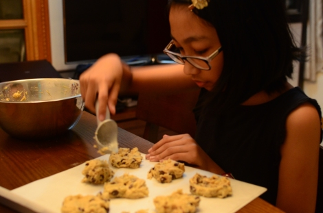 She was the one to scoop and drop the cookie dough on the cooking paper.