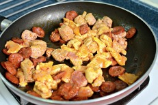 Sauté meat, chorizo first, then pork tenderloin then chicken breast